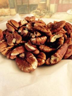 Raw pecan halves, ready to be chopped and toasted.