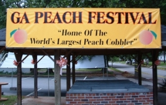 No joke!  The Georgia (State) Peach Festival is home of the World's Largest Peach Cobbler!  Photo source: GA Peach Festival