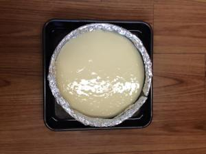 Cheesecake filling poured into prepared pan on top of baked graham cracker crust.