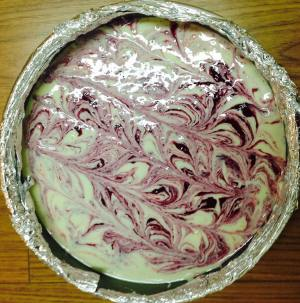 Create a swirl pattern by dragging a butter knife in lines through the mixture.