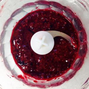 Puréed stewed raspberries in the mini food processor.