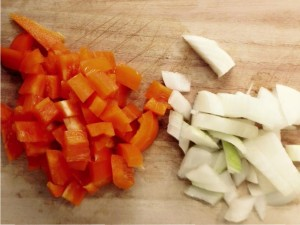 Chopped orange bell pepper and white onion.