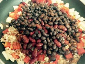 Add the rice, beans, tomato sauce and seasonings all at once and cook until heated through.