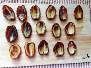 Press each date half into a little bowl or scoop shape to maximize the filling in each one!