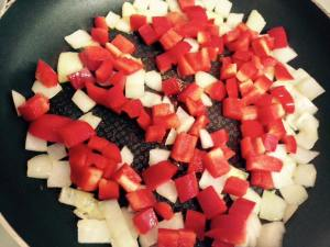 Add the chopped bell peppers and continue cooking until the peppers soften.