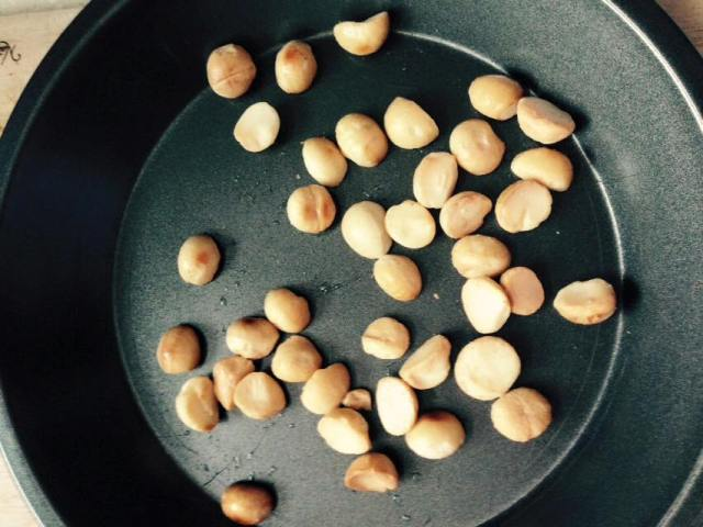 Don't be afraid to roast nuts!  Just spread them in a single layer in a baking dish and put in the oven at 325-350F (165-180C) for 5-10 minutes.  They'll be a beautiful shade of golden brown.  Stick around the kitchen and you'll smell the magic happening too!